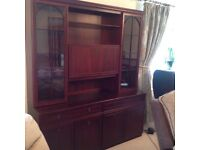 Large wall display and drinks cabinet.