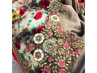 Stunning beige saree with embroidered red blouse