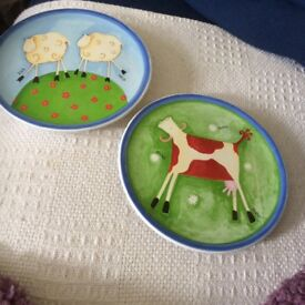 Two decorated hanging plates cow and sheep