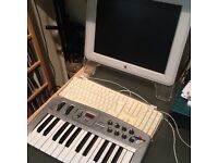 Apple Mac Desktop with music production equipment and software