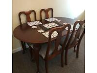 Mahogany extendable dinner table and 4 chairs