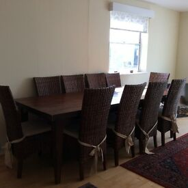 Beautiful solid teak dining table and 10 matching chairs