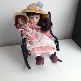 Porcelain doll and rocking chair.