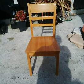 two wooden chairs and cousins