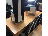 Solid wood large dining table and eight as new leather chairs