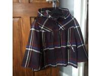 Poncho style wool coat