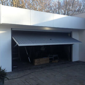 Brand new high quality very large electric garage door. Practically free to qualified buyer.