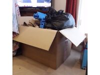 A medium sized moving box, furniture protectors and used bubble wrap scraps