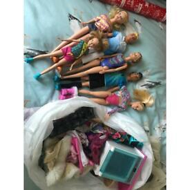 Bag of Barbie and ken dolls dereham