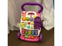 V TECH BABY WALKER AND ACTIVITIES PINK