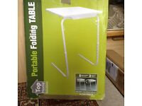 Portable table-can be used for elderly or children- brand new in box