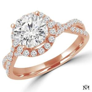 DIAMOND ENGAGEMENT RING WITH A 1.10 CARAT CENTER / BAGUE DE FIANCAILLE AVEC DIAMANT DE 1.10 CARAT