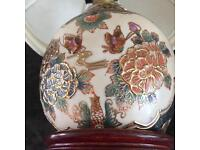 Chinese style lamp hand painted . With wood base, Ideal for lounge bedroom etc .