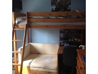 Thuka pine high rise bed with pullout bed and desk. Good condition.
