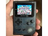 32-Bit Handheld Games console with 800+ top titles built in!