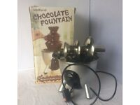 Chocolate Fountain in good clean working condition. Instructions inside. The box is worn.