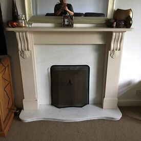 mantle piece and surround with hearth.