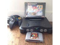 Working Nintendo 64 w/ Pokemon Stadium, boxed Super Mario 64, memory card and controller