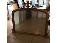Large ornate over mantle mirror in gold colour