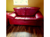 Stylish mondern Real leather sofas. Bright red, good condition, comfy. DELIVERY
