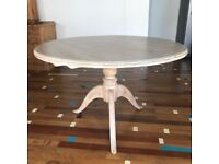 Elegant round table in pine with a white 'washed paint' surface. Seats up to seven