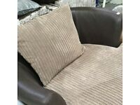 CUDDLER SWIVELLING ARMCHAIR IN CHOCOLATE MIX WITH MATCHING FOOTSTOOL
