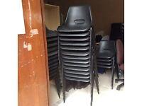 Twenty Black Plastic Adult Stacking Chairs