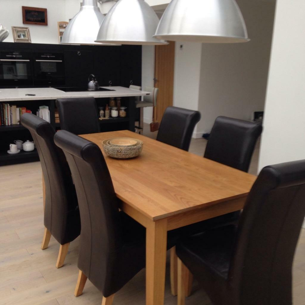 Solid oak dining table and 6 leather chairs in for Dining room tables on gumtree