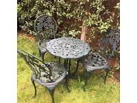 Cast garden table 3 chairs