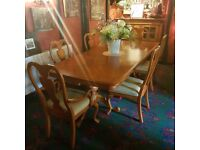 Beautiful antique extending dinning table and 8 chairs