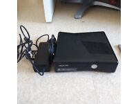 Xbox 360 Slim console all wires controller and a few game's.