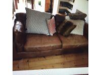 BROWN LEATHER LARGE SOFA ( FURNITURE VILLAGE 4YRS OLD)