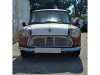 Left hand drive Austin MINI for restoration. Starts and runs. Barn find.