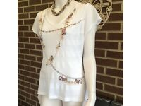 Stizzoli Italian designer top. Size 12-14. New with tags. White and pastel.