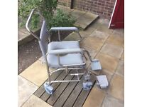 excellent condition wheelchair commode/showerchair