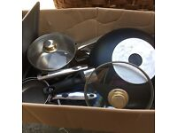 Variety of pots and pans and baking tins, suitable for a boot fair sale