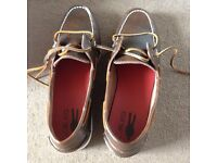Unworn and boxed Mr KG boat shoes in brown with white soles and brown laces