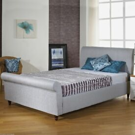 Grey fabric covered double bed + mattress
