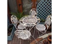 Vintage looking garden table and chairs