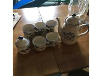 Coffee set with blue floral design.