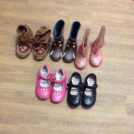 Different collect of children's shoes, boots and wellies