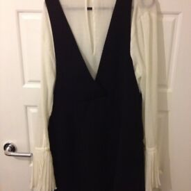 Ladies black pinafore and blouse. (Can be bought seperately)