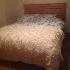 Kingsize oak bed forsale.