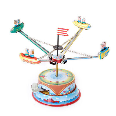 SPINNING CAROUSEL SPACESHIP MERRY GO ROUND TIN TOY IN BOX COLLECTIBLE
