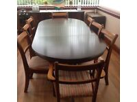 Beautiful mahogany dining table, as new plus 8 chairs