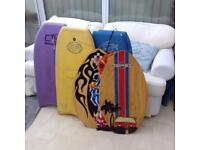 4 body boards and 3 wooden skim boards