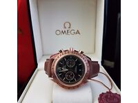 Smart Omega Dark Side Of The Moon with black face, rose gold casing and a leather light brown strap