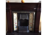 Mahogany fireplace surround with tiles