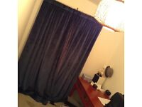 Heavy lined blue velvet curtains