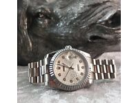 New Rolex date-just with silver bracelet and silver face comes complete with box bag and paperwork